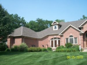 Home with a fixed roof in Dayton, OH from a roofing contractor from Buckeye Home Services